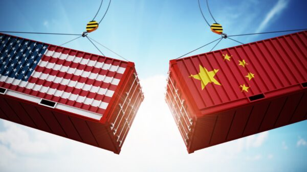 Trade wars concept with American and Chinese flag textured cargo containers clashing. 3D illustration